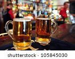 two cups of beer in a pub in...   Shutterstock . vector #105845030