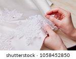 woman hands close up sewing a... | Shutterstock . vector #1058452850