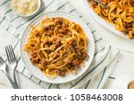 homemade italian ragu sauce and ... | Shutterstock . vector #1058463008