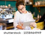 confident restaurant manager... | Shutterstock . vector #1058464949