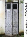 old wooden door on concrete... | Shutterstock . vector #1058466449