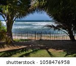 palms  fence and ocean. the... | Shutterstock . vector #1058476958