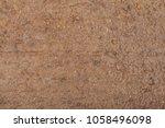 muddy brown texture. slobber... | Shutterstock . vector #1058496098
