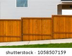 new home backyard red stained... | Shutterstock . vector #1058507159