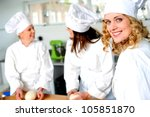 Group of professional female chefs in commercial kitchen - stock photo