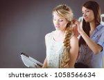 young woman hairdresser do... | Shutterstock . vector #1058566634