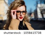 fashion young girl in glasses.... | Shutterstock . vector #1058615738
