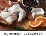 raw chicken legs and marinade... | Shutterstock . vector #1058639699