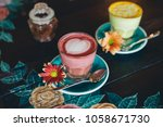 pink latte drink and yellow... | Shutterstock . vector #1058671730