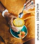 turmeric latte yellow drink | Shutterstock . vector #1058671949