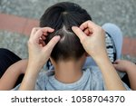 mother is catching hair to find ... | Shutterstock . vector #1058704370