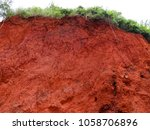 A Cliff Of Dry Red Dirt Along ...
