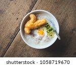 bowl of congee or rice porridge ... | Shutterstock . vector #1058719670