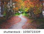 beautiful sidewalk in fall... | Shutterstock . vector #1058723339
