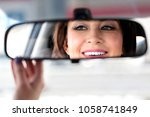 smiling happy woman car driver... | Shutterstock . vector #1058741849