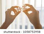 two hands of businessmen help... | Shutterstock . vector #1058752958