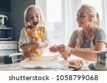 beautiful blond mom teaching... | Shutterstock . vector #1058799068