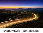 early morning sunrise over... | Shutterstock . vector #1058801300