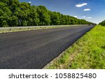 road roller rolls freshly laid... | Shutterstock . vector #1058825480