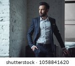 handsome confident man in suit... | Shutterstock . vector #1058841620