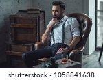 handsome pensive man is... | Shutterstock . vector #1058841638