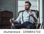 handsome pensive man is holding ... | Shutterstock . vector #1058841710