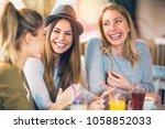 friends enjoying in... | Shutterstock . vector #1058852033