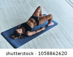 motivated to shape her body.... | Shutterstock . vector #1058862620