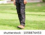 man wearing black cargo pants... | Shutterstock . vector #1058876453