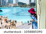 fashionable girl enjoying the... | Shutterstock . vector #1058885390