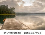 Wooden Pier On Lake Site Facing ...