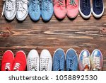 female stylish shoes on wooden... | Shutterstock . vector #1058892530