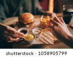 group of friends eating at fast ... | Shutterstock . vector #1058905799