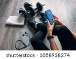 girl uses fitness app | Shutterstock . vector #1058938274