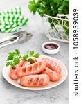 grilled sausages on plate. bbq... | Shutterstock . vector #1058939039