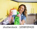 beautiful young smiling woman... | Shutterstock . vector #1058939420