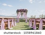 arch  decorated with trunks and ... | Shutterstock . vector #1058961860