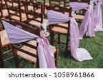 chairs decorated with fabric... | Shutterstock . vector #1058961866