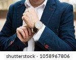 elegant man in blue suit ...   Shutterstock . vector #1058967806