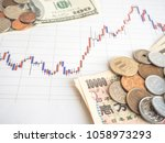 investment stock chart money | Shutterstock . vector #1058973293