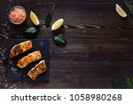 cooked salmon on wooden... | Shutterstock . vector #1058980268