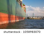 large container ship unloading... | Shutterstock . vector #1058983070