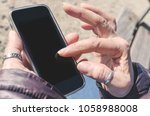 detailed view on hands of... | Shutterstock . vector #1058988008