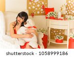 sensual latin  woman with toy... | Shutterstock . vector #1058999186