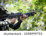 closeup squad of soldiers... | Shutterstock . vector #1058999753