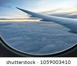 view from airplane  looking... | Shutterstock . vector #1059003410