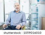 mature man with grey hair and... | Shutterstock . vector #1059016010