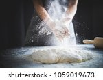 making dough by female hands at ... | Shutterstock . vector #1059019673