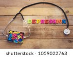 Small photo of concept depression, heart stethoscope and colorful letters in metal box