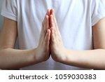 children's hands folded...   Shutterstock . vector #1059030383